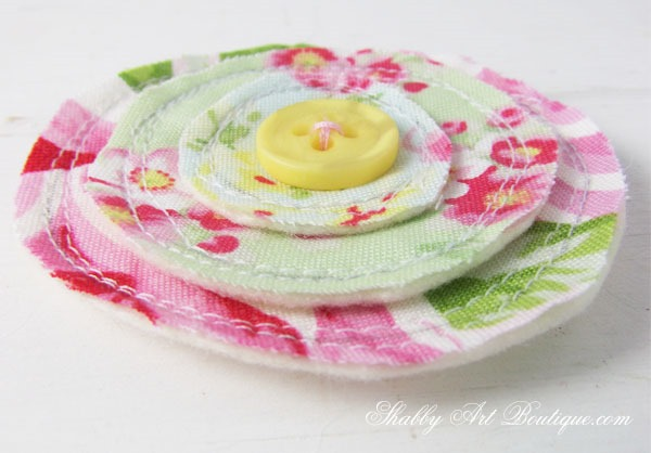 Tutorial for making these sweet scrappy fabric flowers by Shabby Art Boutique