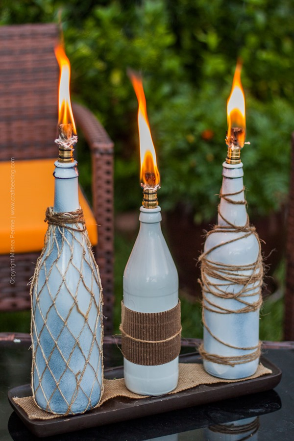 Beer-Bottle-Tiki-Torch-Trio-Lit-Up-3SM