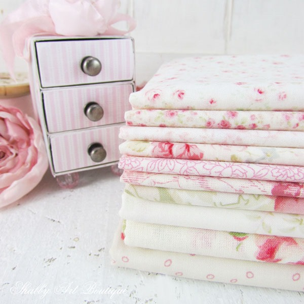 Pretty stack of pink floral fabrics for faux patchwork project by Shabby Art Boutique