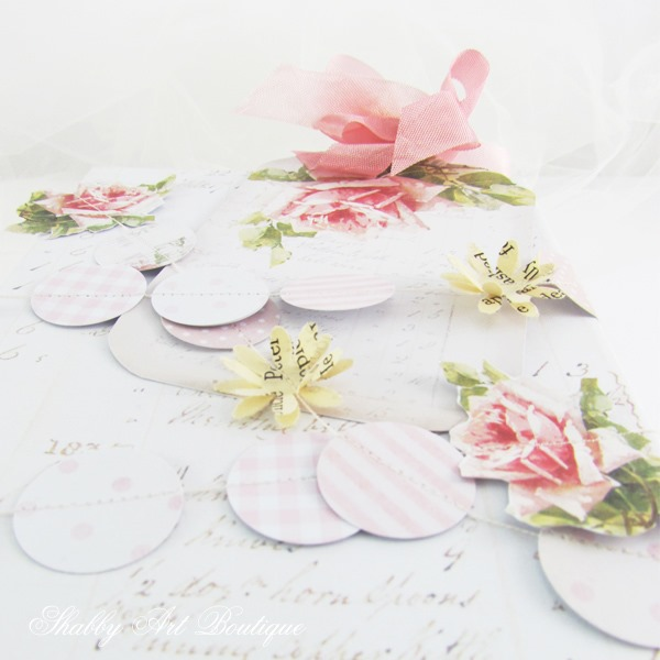 Take a gift from ordinary to extraordinary with this easy to make vintage rose punched paper garland by Shabby Art Boutique