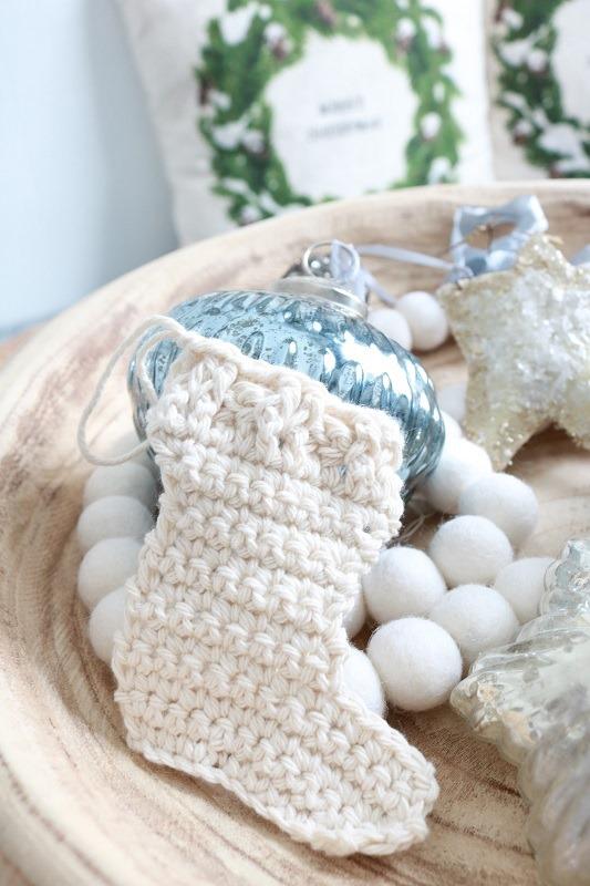 Crochet-Christmas-Stocking-Ornament-in-bowl-closeup